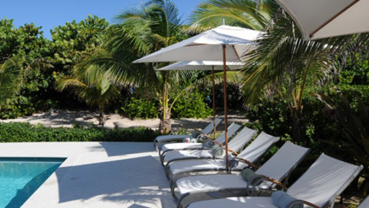 Luxury boutique hotel cayman cotton tree grand cayman for Small luxury hotel 7 little words
